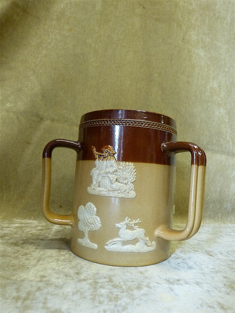 A Royal Doulton Glazed Stoneware 3-Handled Loving Cup on brown gr