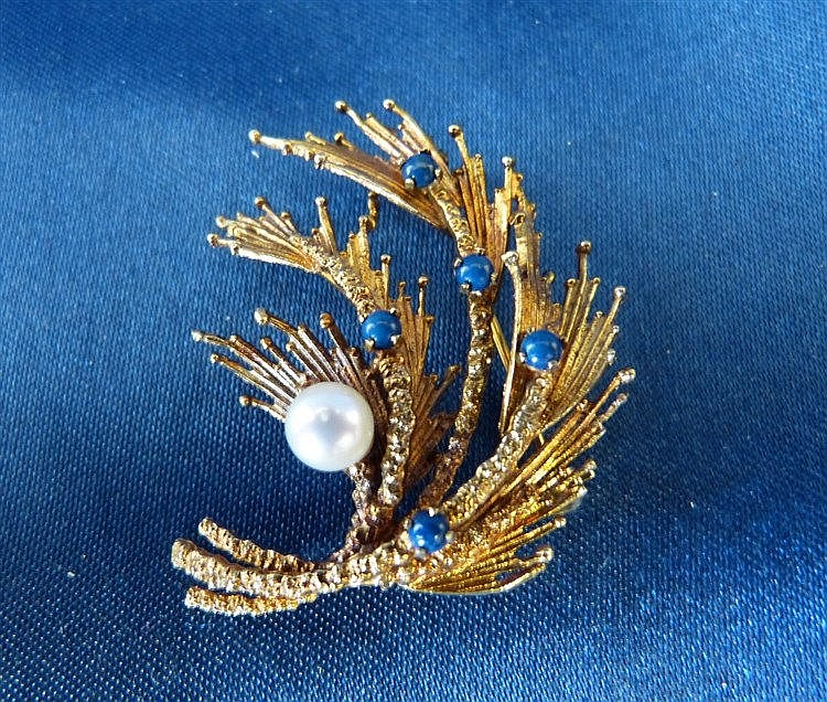 A 9ct Gold Floral Brooch set with 5 blue stones and pearl, 7.6gms