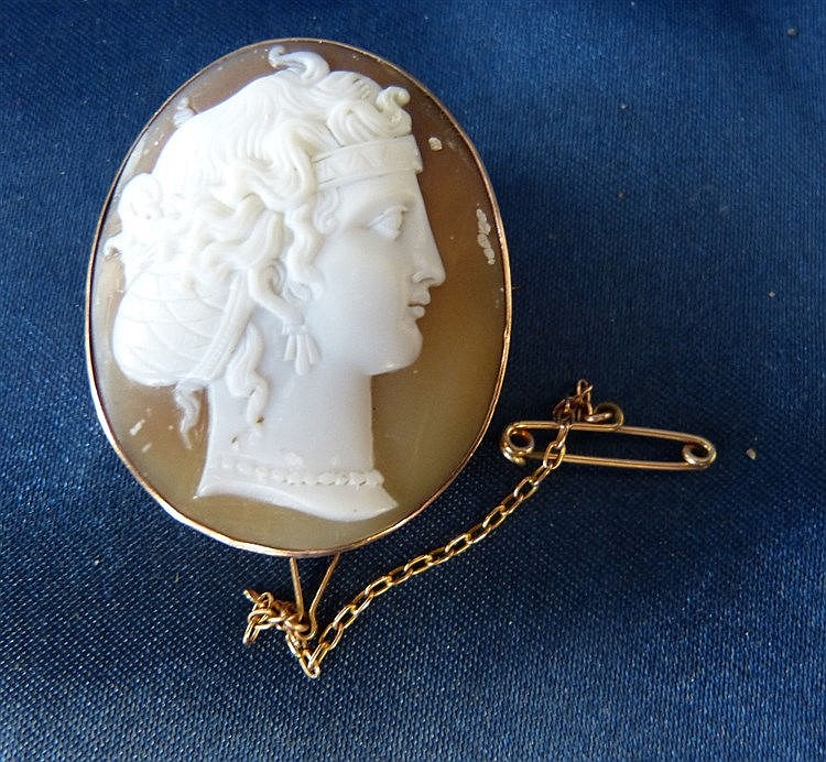 An Oval Cameo Shoulder Length Portrait of a Lady in gold pendant