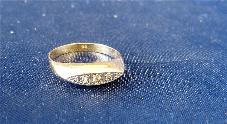 A Gold Ladies Boat Shape Ring set with 5 small rough cut diamonds