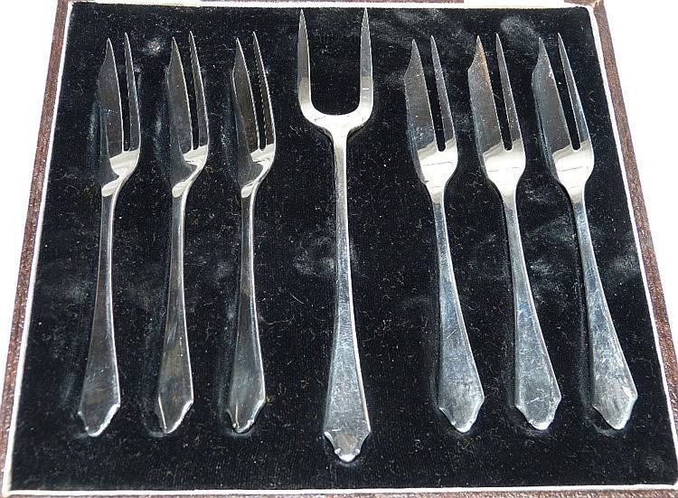 A Set of 6 Birmingham Silver Cake Forks and matching serving fork