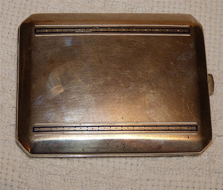 A Continental Silver Coloured Metal Cigarette Case having blue an