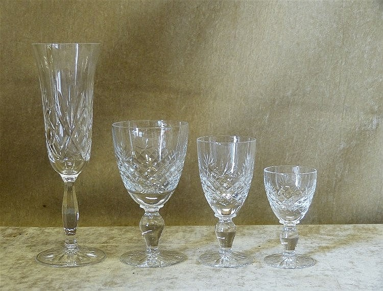 A Set of 6 Cut Glass Champagne Flutes, a set of 6 small wine glas