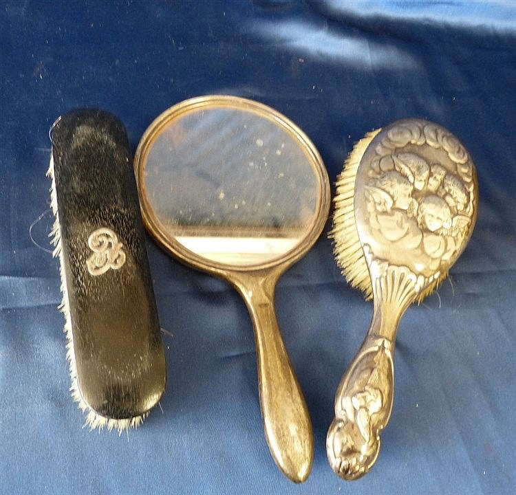 A London Silver Hair Brush having embossed Cupid motifs, a Birmin