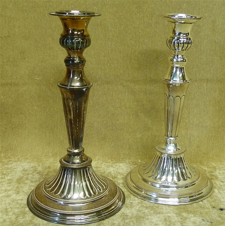 A Pair of Elkington Silver Plated Candlesticks on turned stems ha
