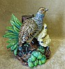 A 19th Century Majolica Group of Bird and her chicks having leaf