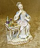 A Meissen Figure of a Seated Lady eating from table, 13cm high
