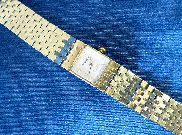 A 14ct Gold Nivada 17 Jewel Wrist Watch with matching strap brace