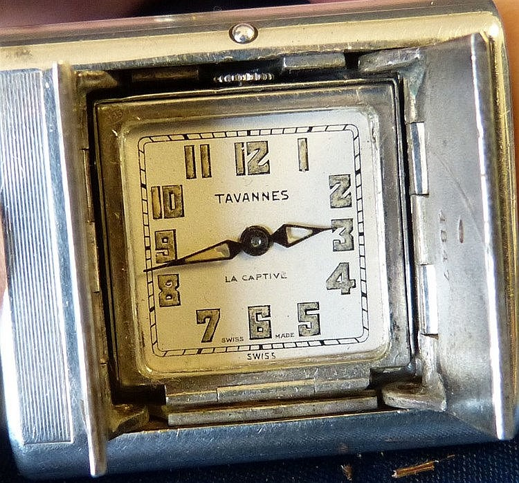 An Art Deco 925 Silver Travelling Tavannes Watch having squeezabl