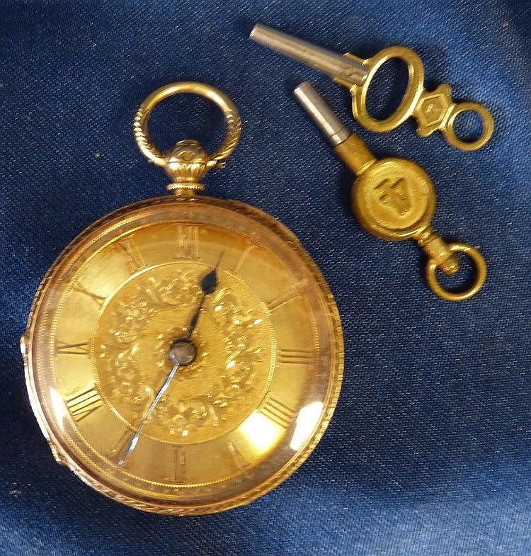 An 18ct Gold Open Face Fob Watch with raised Roman numerals and e