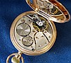 A 9ct Gold Half Hunter Pocket Watch having white enamel dial with