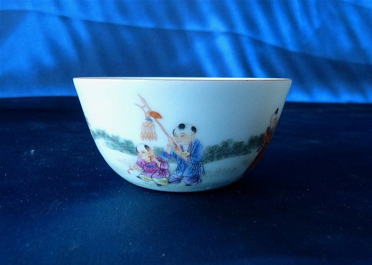 An Oriental Round Tea Bowl having multicoloured children decorati
