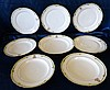 13 Limoges Dinner Plates and 2 matching larger plates having gree