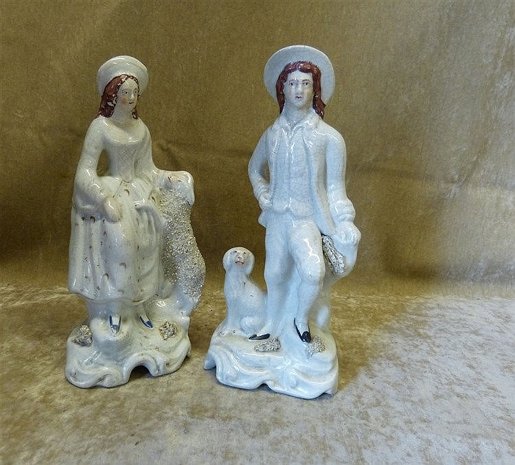 A Pair of Victorian Staffordshire Figures of Gentleman and Lady s