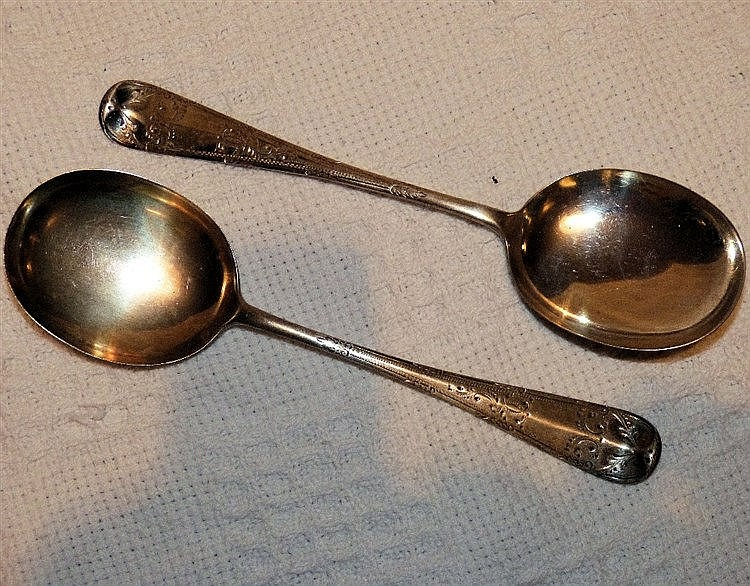 A Pair of Sheffield Silver Rat Tails Spoons having chased handles