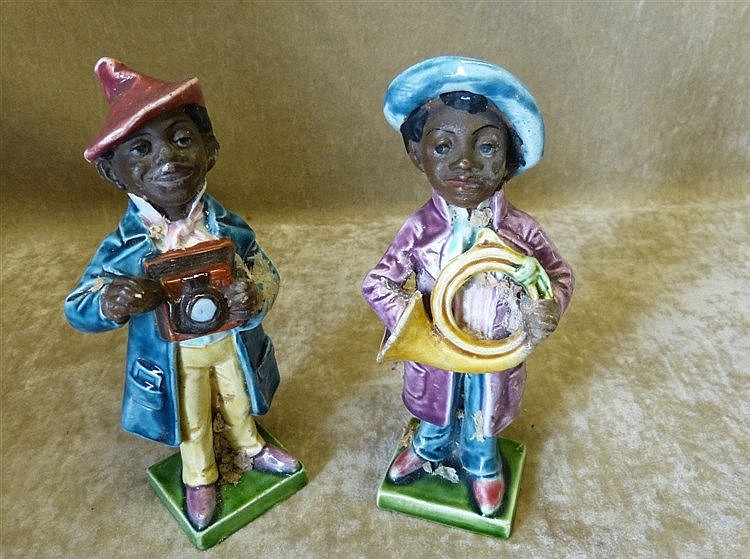 2 Glazed Earthenware Figures of African Boys with trumpet and cam
