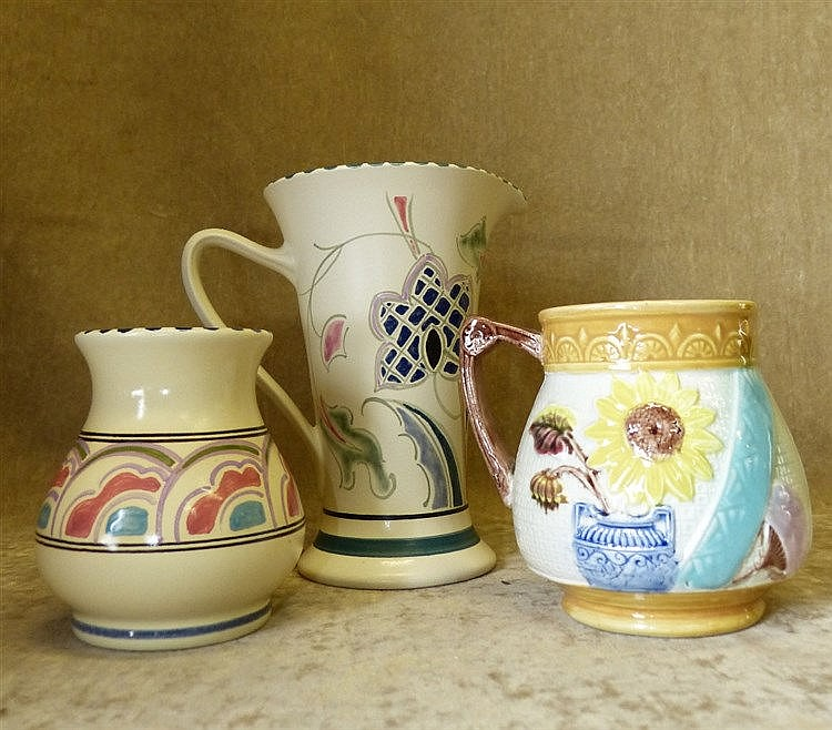 A Honiton China Trumpet Shape Jug having multicoloured floral and