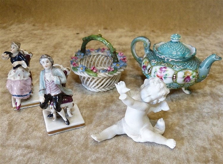 A pair of Continental Miniature Porcelain Figures of seated gentl