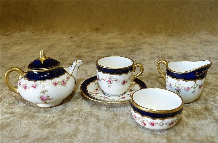 A Miniature Coalport Bachelors Tea Service on white and blue grou