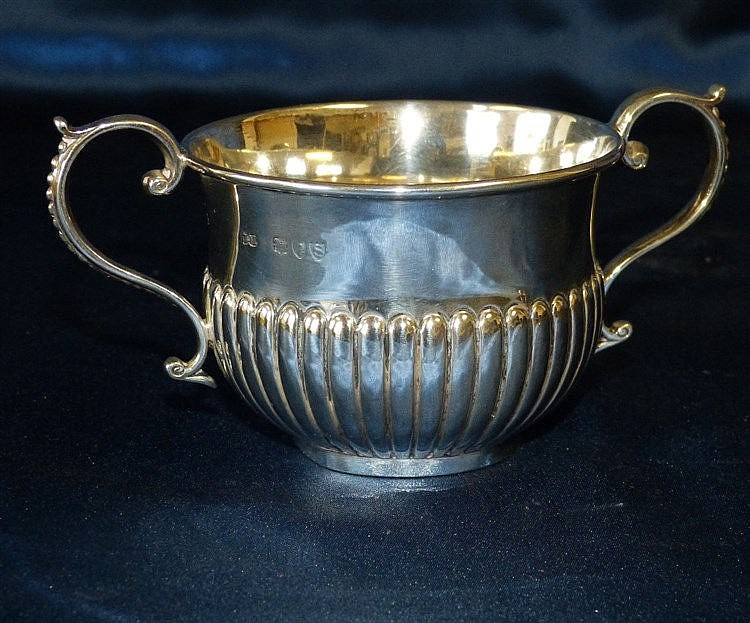 A Victorian Silver 2-Handled Porringer having half embossed reede