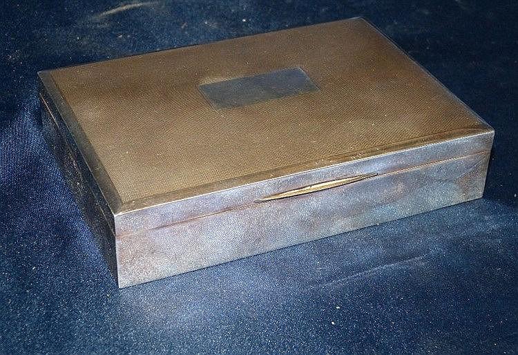 A Birmingham Silver Rectangular Cigarette Box having engine turne