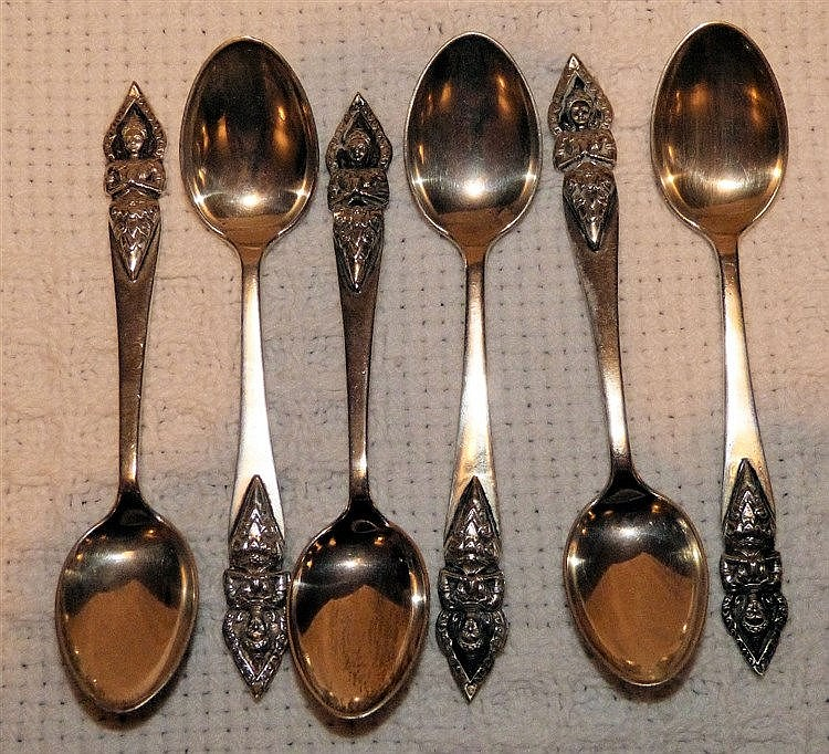 A Set of 6 Sterling Silver Small Coffee Spoons having eastern fig