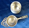 A Birmingham Silver Tea Strainer having pierced handle on bulbous