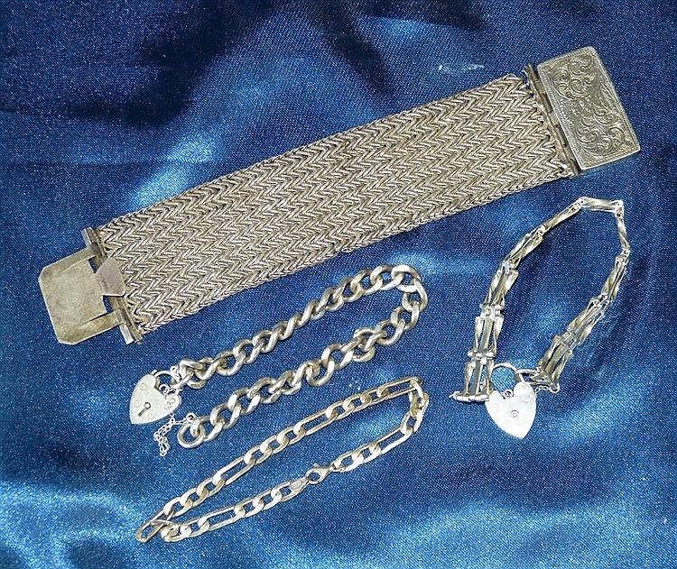 A Silver Bracelet having padlock clasp another silver gate bracel
