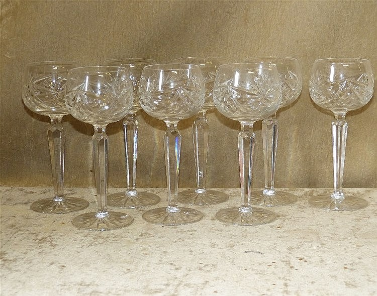 A Set of 8 Cut Glass Hock Glasses on hexagonal stems with round b