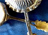 An Imported Silver Spoon having sunburst motif, another 800 silve