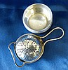A Birmingham Silver Tea Strainer with matching bulbous shape stan