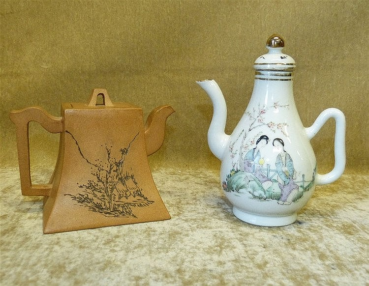 An Oriental Earthenware Square Teapot having engraved building an