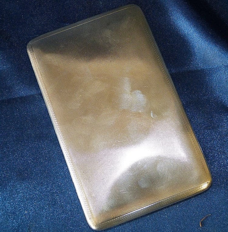 A Mappin and Webb Birmingham Silver Cigarette Case having engine