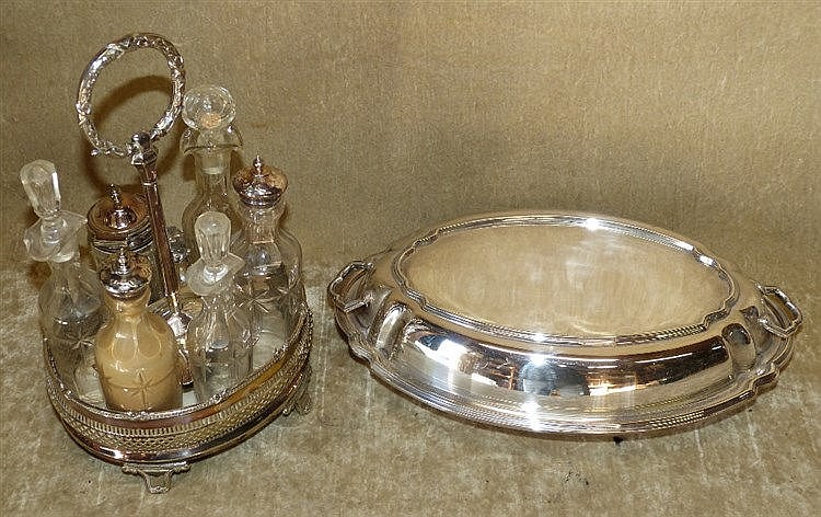 A Silver Plated Oval Cruet Stand having centre carrying handle, s