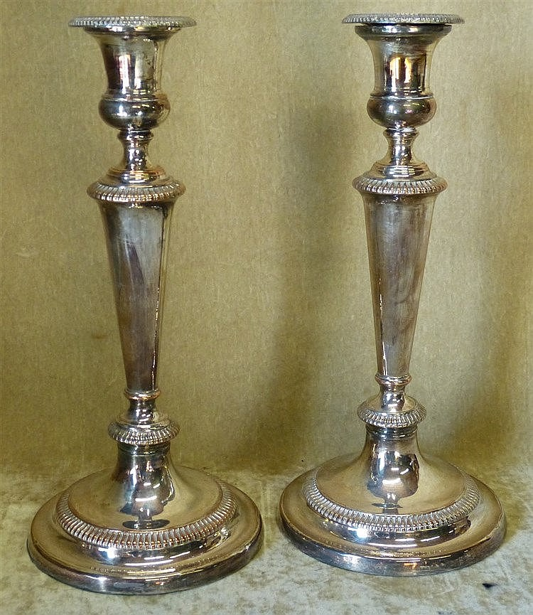 A Pair of Silver Plated Candlesticks on turned stems having round