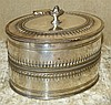 A Silver Plated Oval Tea Caddy having hinged lid (interior divide