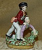 A 19th Century Staffordshire Group depicting 2 boys tussling taki