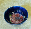 A Moorcroft Small Round Bowl on blue ground with coloured floral