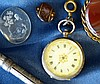 A Silver Fob Watch having chased decoration, a silver pendant, an