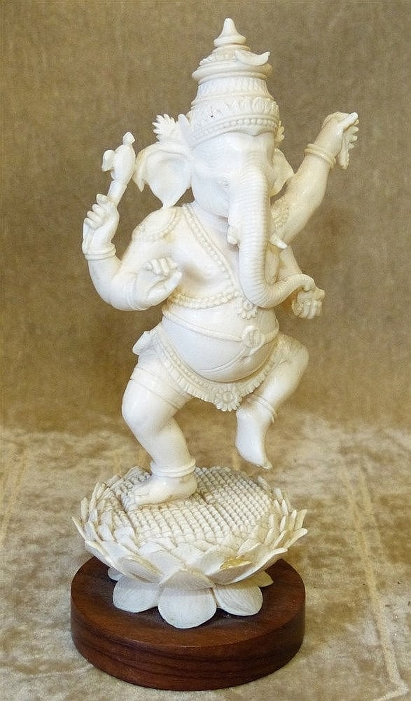 An Early 20th Century Ivory Figure of a Dancing Elephant God on h