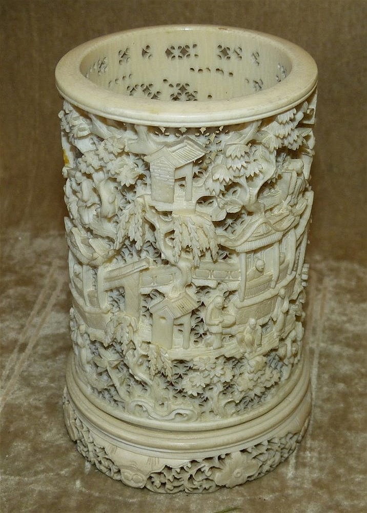 A 19th/20th Century Oriental Carved Ivory Vase having pierced fig