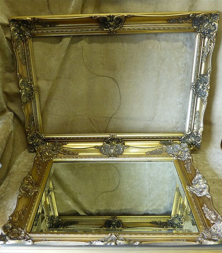 A Gilt Hanging Modern Bevelled Wall Mirror with raised floral and