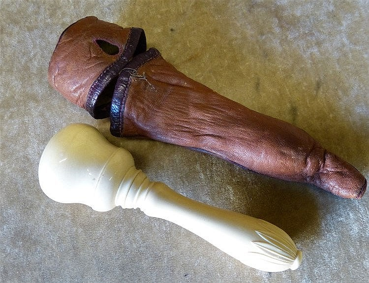A 19th Century Ivory Gavel having turned handle with leather cove