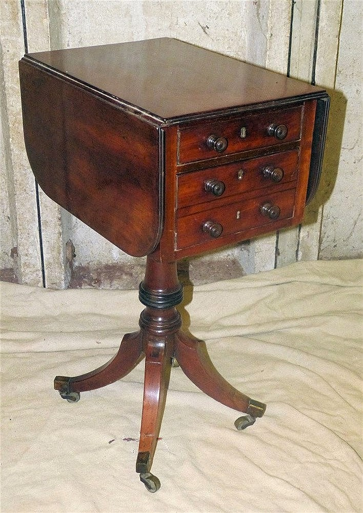 A 19th Century Mahogany Drop-Leaf Workbox having reeded rim, 3 dr