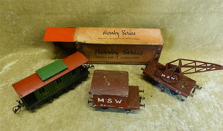 A Hornby O'Gauge Caboose, Boxed a similar crane and wagon (3)
