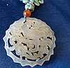 An Oriental Jade Round Pierced Plaque having bird and floral deco