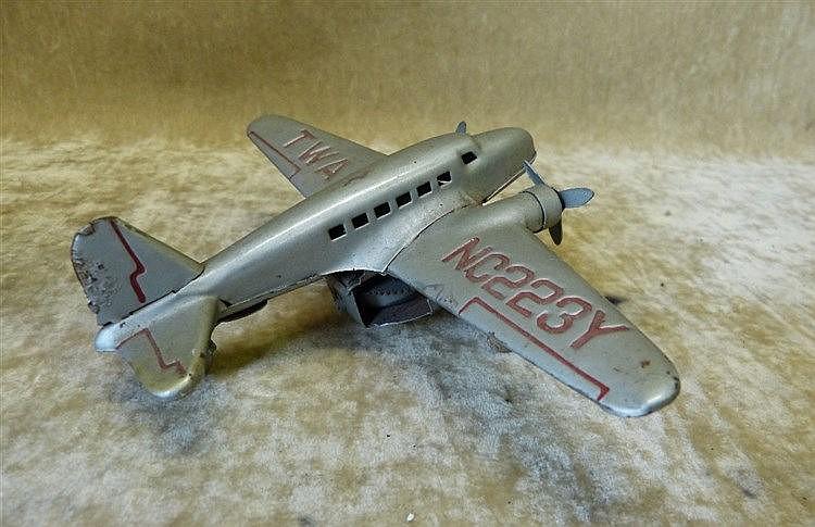 A Clockwork TWA NC223Y Aeroplane 12cm long