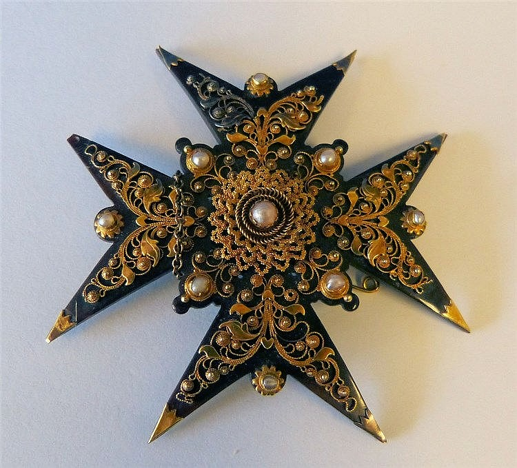 A Tortoiseshell and Gold Mounted Cross Brooch having raised half
