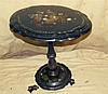 A 19th Century Papier Mache Oval Tilt Top Occasional Table having
