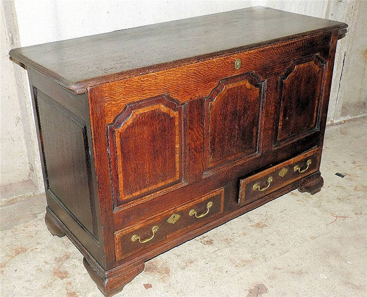 An 18th Century Oak Mule Chest having hinged lid enclosing candle